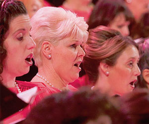 Women singing in a choir by More Good Foundation